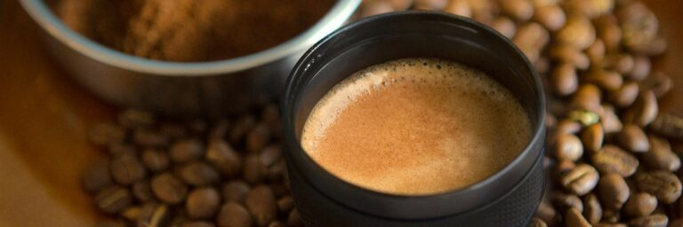 Close up on a cup of coffee made by a camping coffee maker